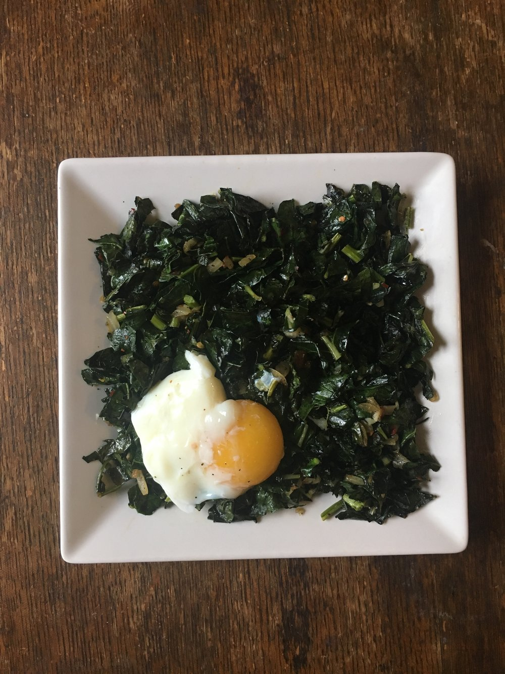 garlic sauteed kale with poached eggs
