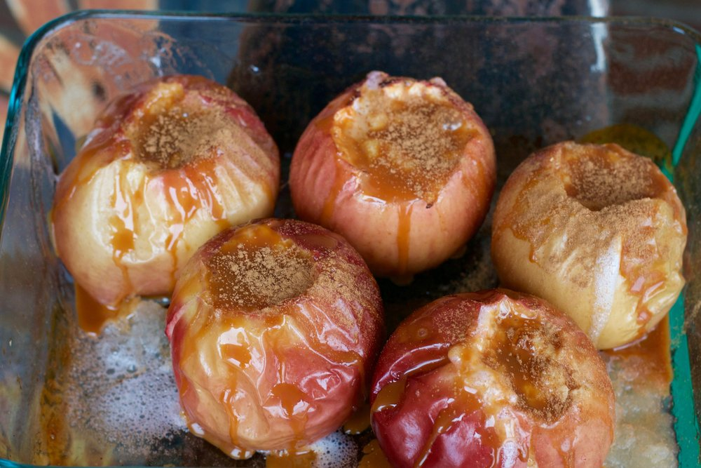 baked apples with custard, caramel, and cinnamon