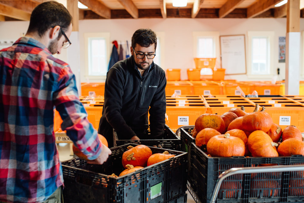 Nick and Bobby packing up organic kabocha squash at the Intervale Food Hub