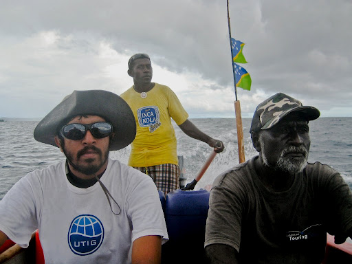 Ricky (background), our boat driver, Alison (right), our collaborator from the Geology Mines Dept. and I aboard Alison's 18-ft Laizala traveling from North Ranongga to Ghizo