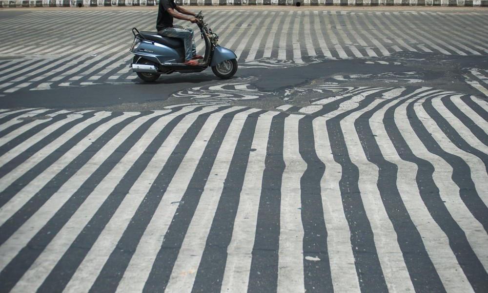 Melted asphalt on Indian roads during May, 2015 [ Source ]