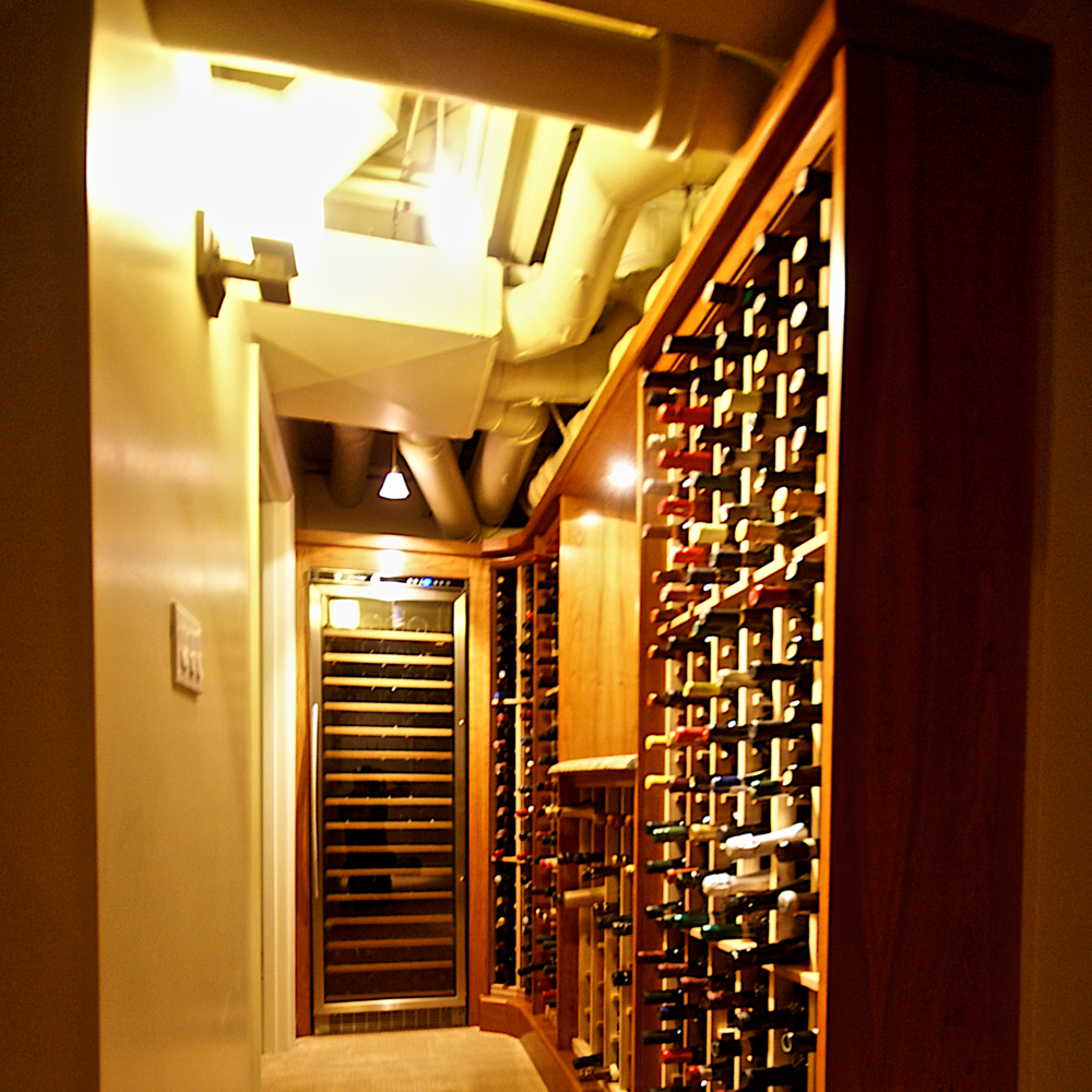 After:Wine storage for nearly 600 bottles including refrigeration and space for magnums