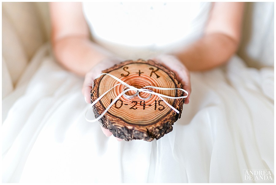 wedding bands in an engraved wood with their initials, beautiful keepsake