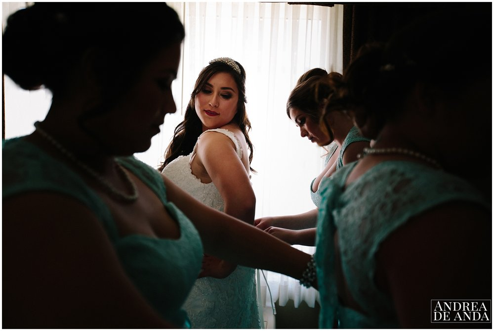 Bride and Bridesmaids at getting ready room, silhouette and backlight for moody effect