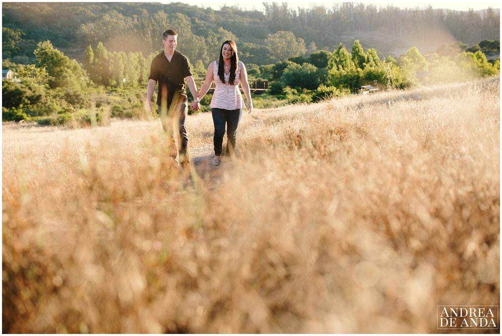 Walking together by the trail Engagement session Orcutt Hills, Bride and Grooms portraits by Andrea de Anda Photography