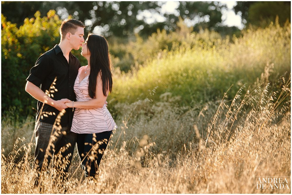 Kissing her nose, romantic posing Engagement session Orcutt Hills by Andrea de Anda Photography