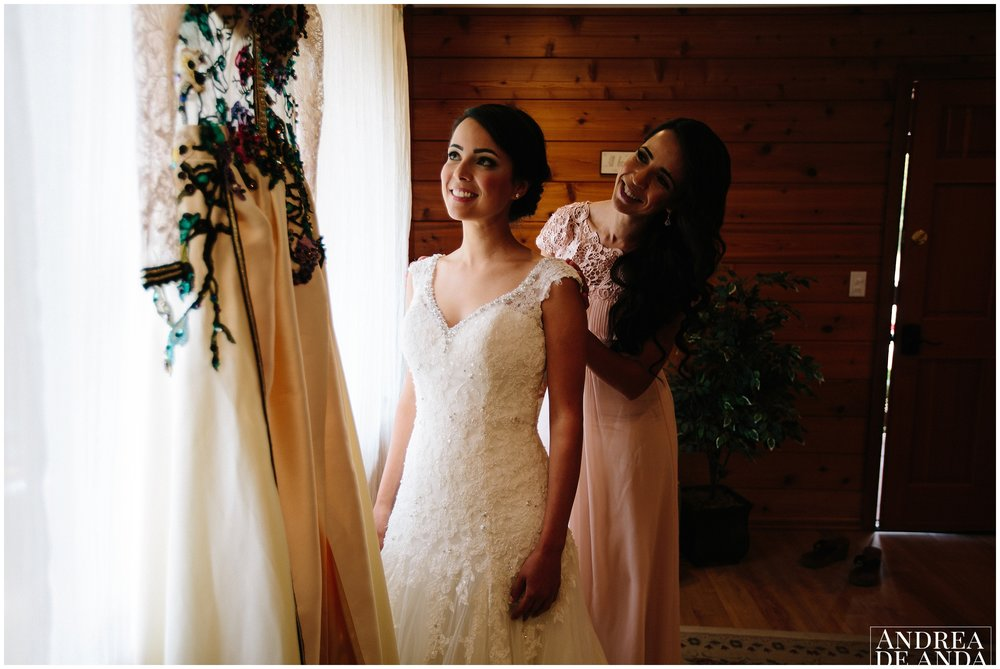 bride and sister admiring moroccan weddign dress