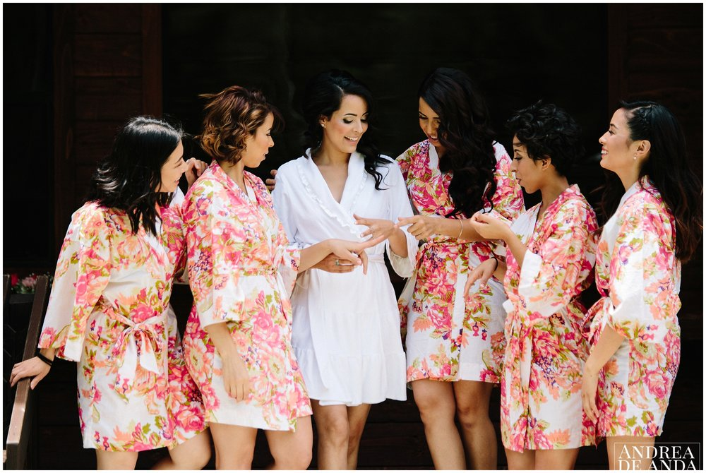 bride and bridesmaids in robes having fun