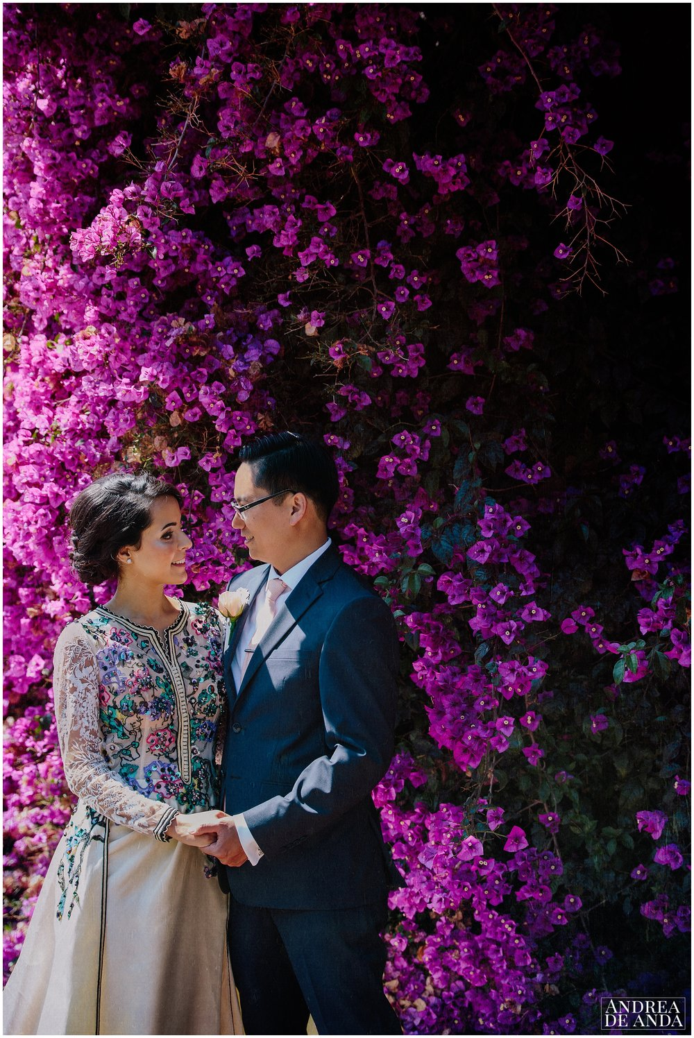 Bride and Groom  against a Bougainvillea wall Creative Pictures in Lion's Park Carpinteria