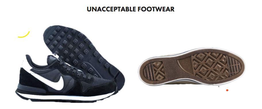 Unacceptable footwear showing marking soles