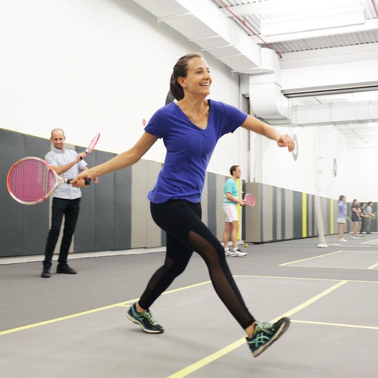 Woman hitting ball at FOAM tennis