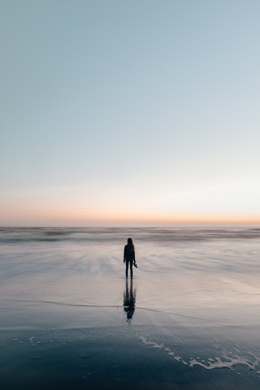 woman-wades-in-ocean-at-sunset.jpg
