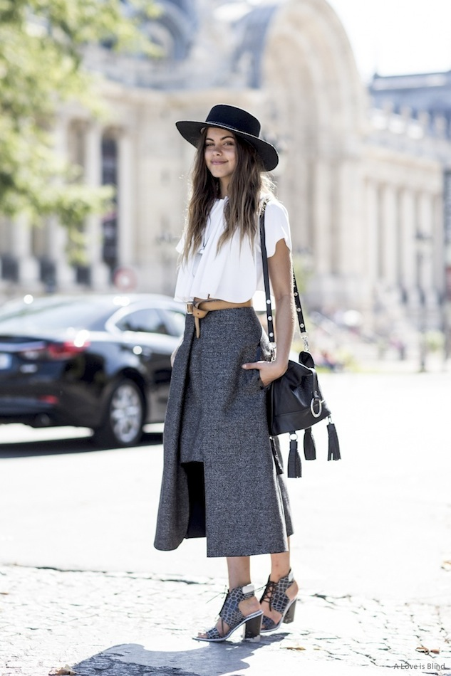 Le-Fashion-Blog-Street-Style-Flat-Top-Hat-Crop-Top-Fringe-Tassel-Bag-Knot-Belt-Shelter-Midi-Skirt-Croc-Sandals-Via-A-Love-Is-Blind.jpg