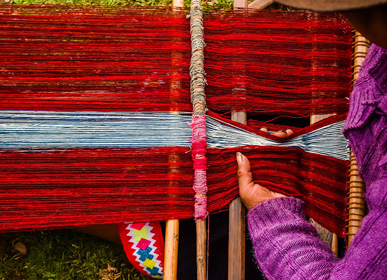 Weaving via back strap loom | Photo by Rock + Pillar