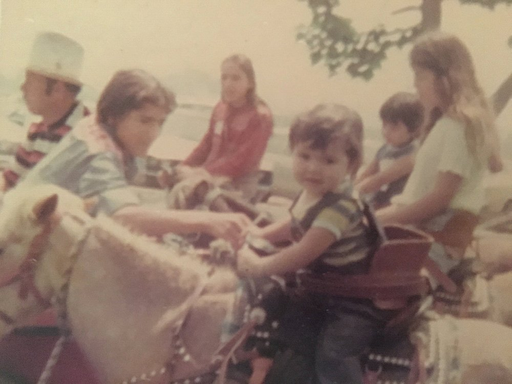 The young man making sure I'm safe on this pony was my Tio Victor.  He was one of my greatest loves. He died a violent death in 2003 and after witnessing firsthand the bloody aftermath, I've never been the same.  But he visits me in dreams and guides me in ways that confirm to me the spirit world is real.