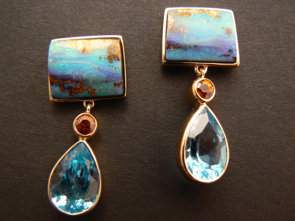 Here's an example of the client having unset blue topaz drops and wanting to pair them with something. She fell in love with these boulder opals that I had in the safe. We also found the perfect accent color in my stash of gems. The inspiration for the earrings was born that day.
