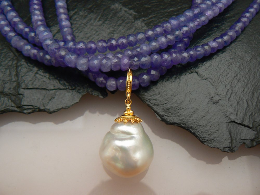 South Seas pearl, 18ky bail and cap, and tanzanite beads
