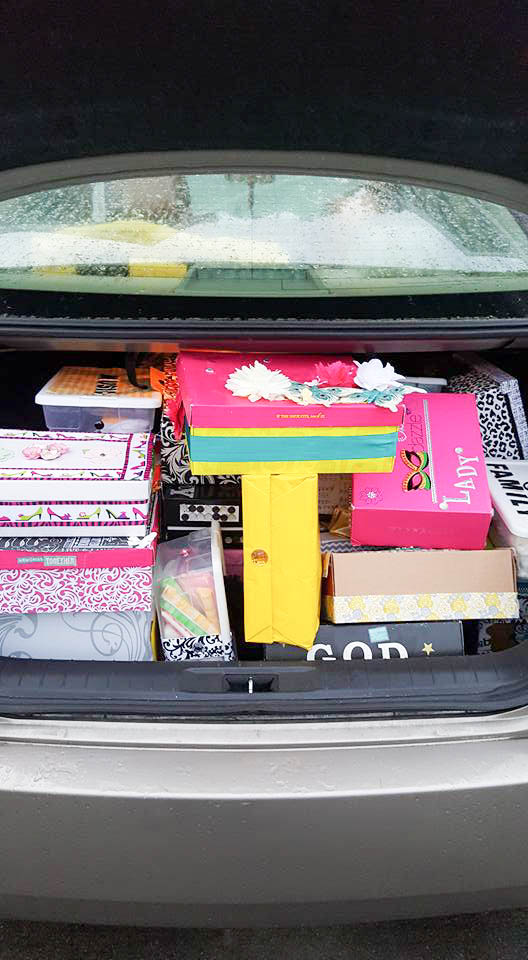 The Trunk of Mrs. Tracys car, packed with shoeboxes ready for drop off.