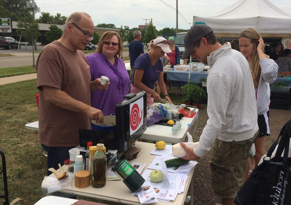 Food sampling at Farmers Market 2014