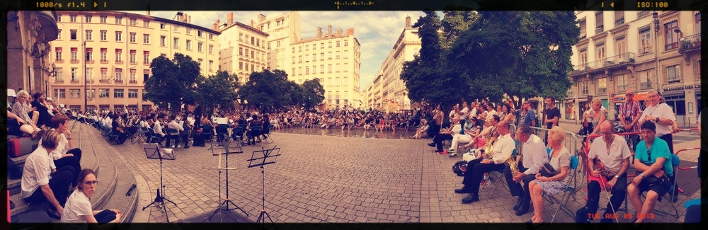 The combined Orchestras play to a great audience in the Place de Celestins in Lyon, France. Photo courtesy of  AYS