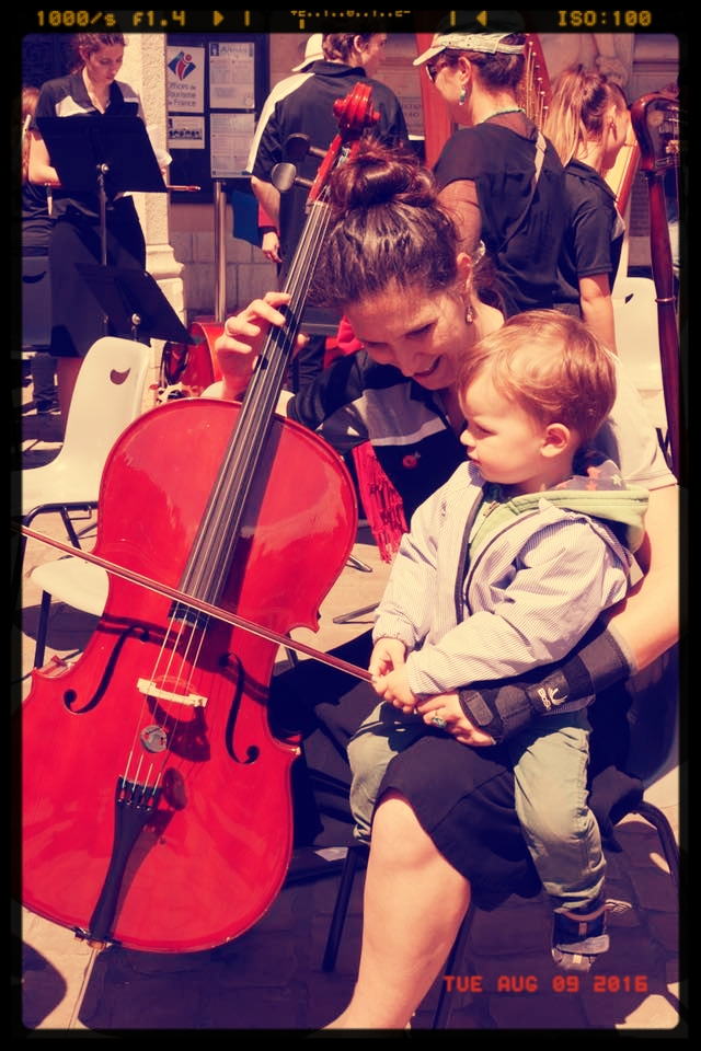 This little guy was just fascinated by the cello section when we played in Arras. So I gave him a quick lesson. Photo courtesy of  AYS