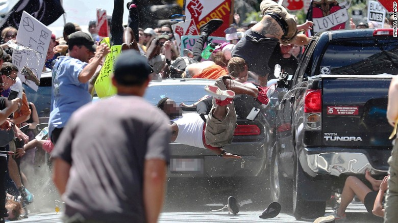 Look at this and let us all weep for our country. See the shoes under the car? God's justice will not sleep long. Photo Source: http://www.cnn.com/2017/08/13/us/charlottesville-white-nationalist-rally-car-crash/index.html