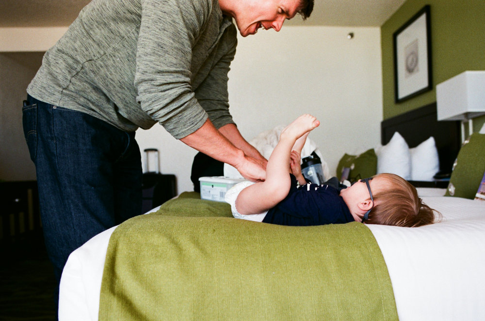 diaper changing with daddy. shot on fuji superia 400.
