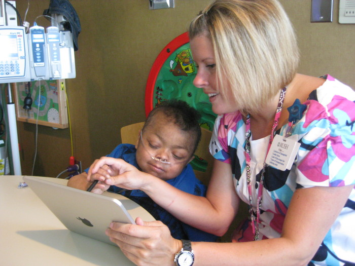 Nevin Jamason with Kristy Rowe and her iPad.  ( childrendaytons.org)