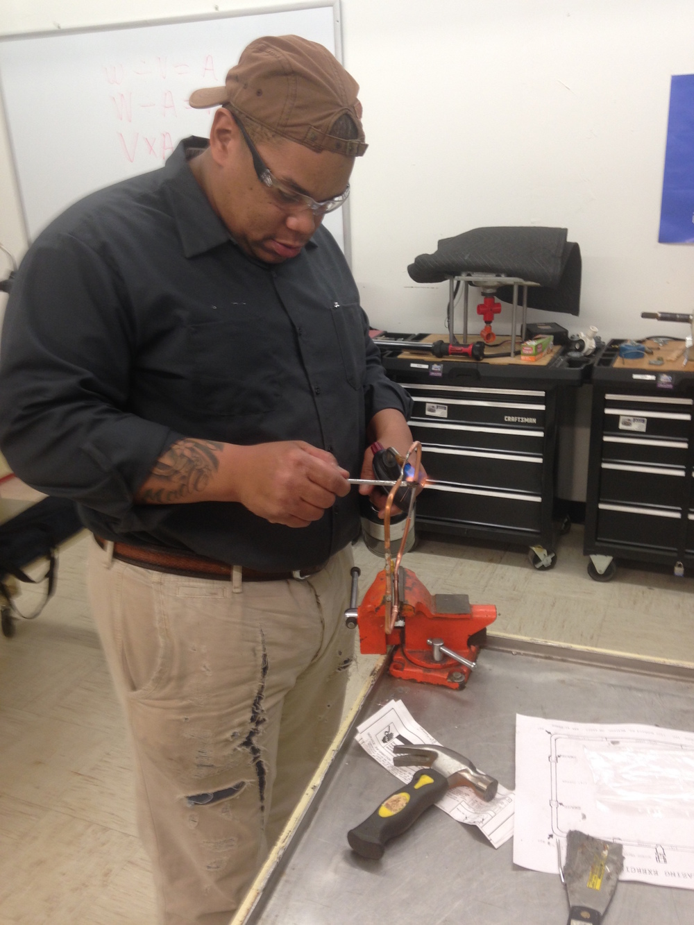 Rod Braxton, owner, displays a brazing technique for refrigeration.
