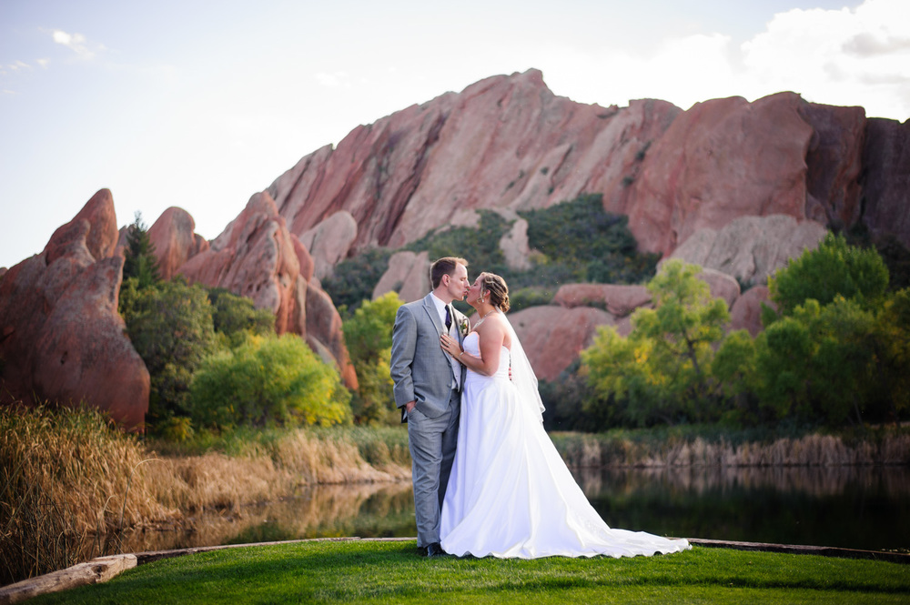Bride and Groom kiss at Arrowhead Golf Club