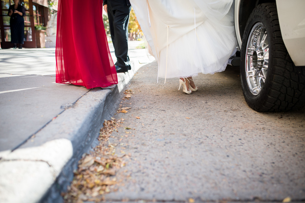 bride shoes as stepping into limo in Denver