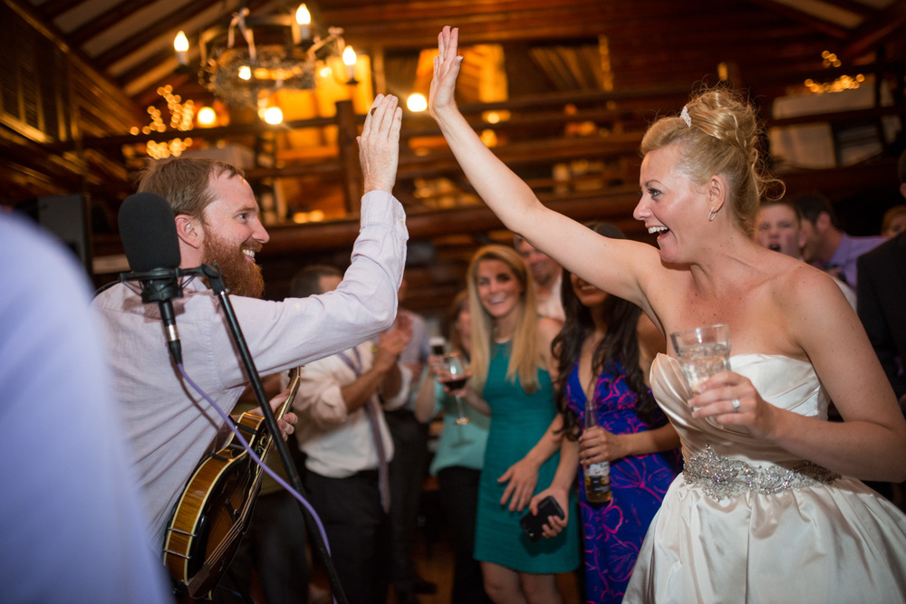 bride high fives band in Estes Park wedding