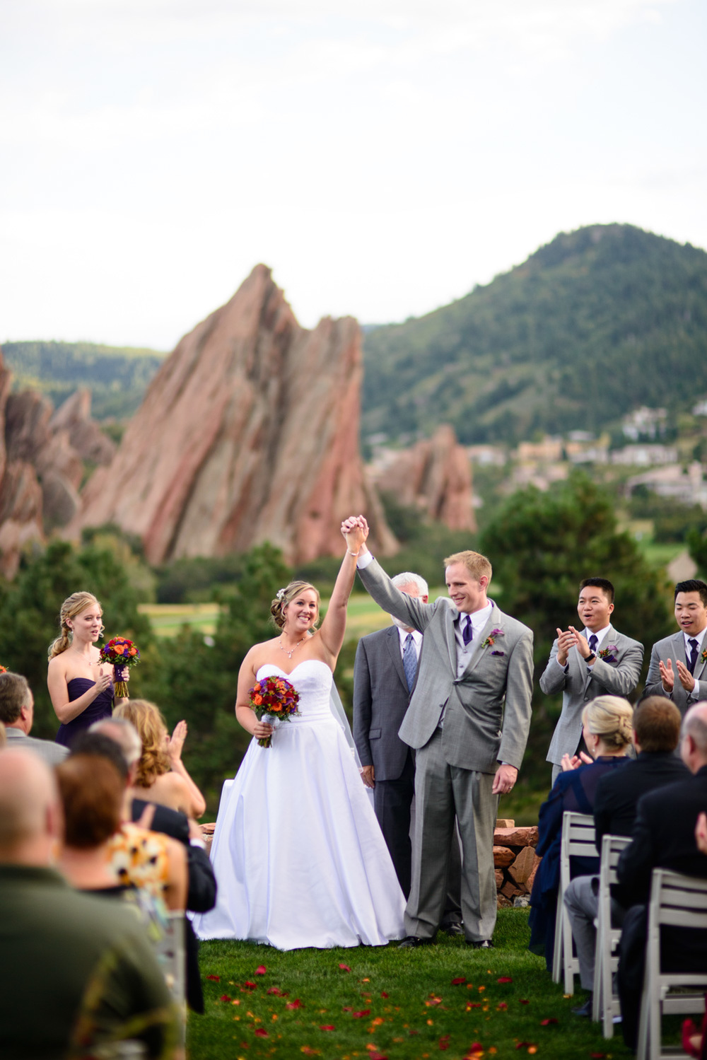 Bride and groom celebrate after ceremony at Arrowhead Golf Course wedding