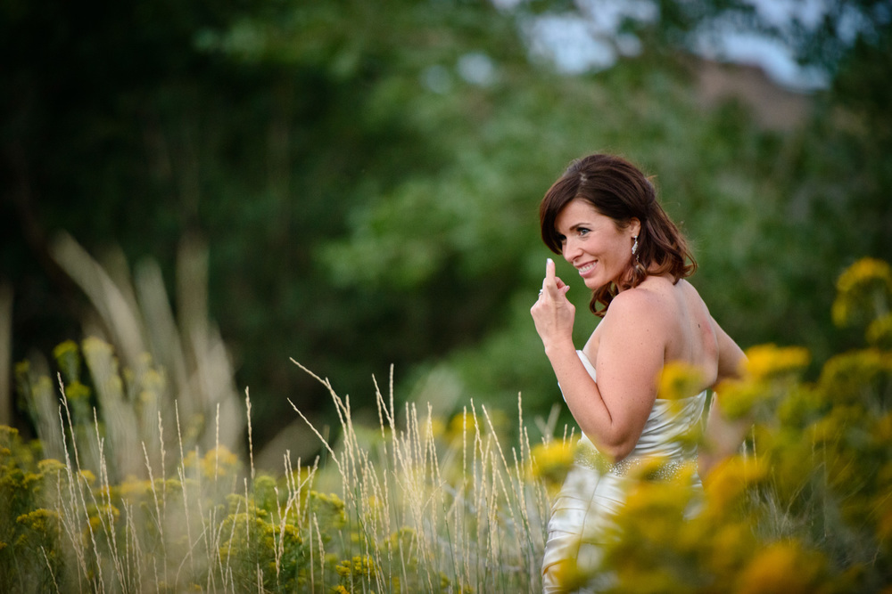 fun portrait of bride in flowers in Golden Colorado