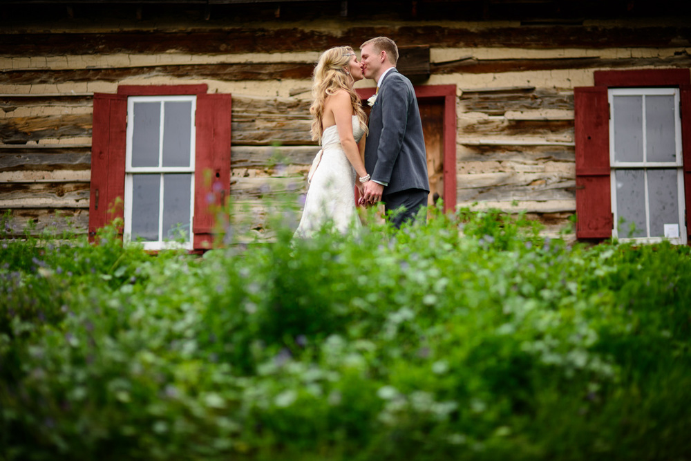 Bride and groom kiss in Golden Historic Park colorado