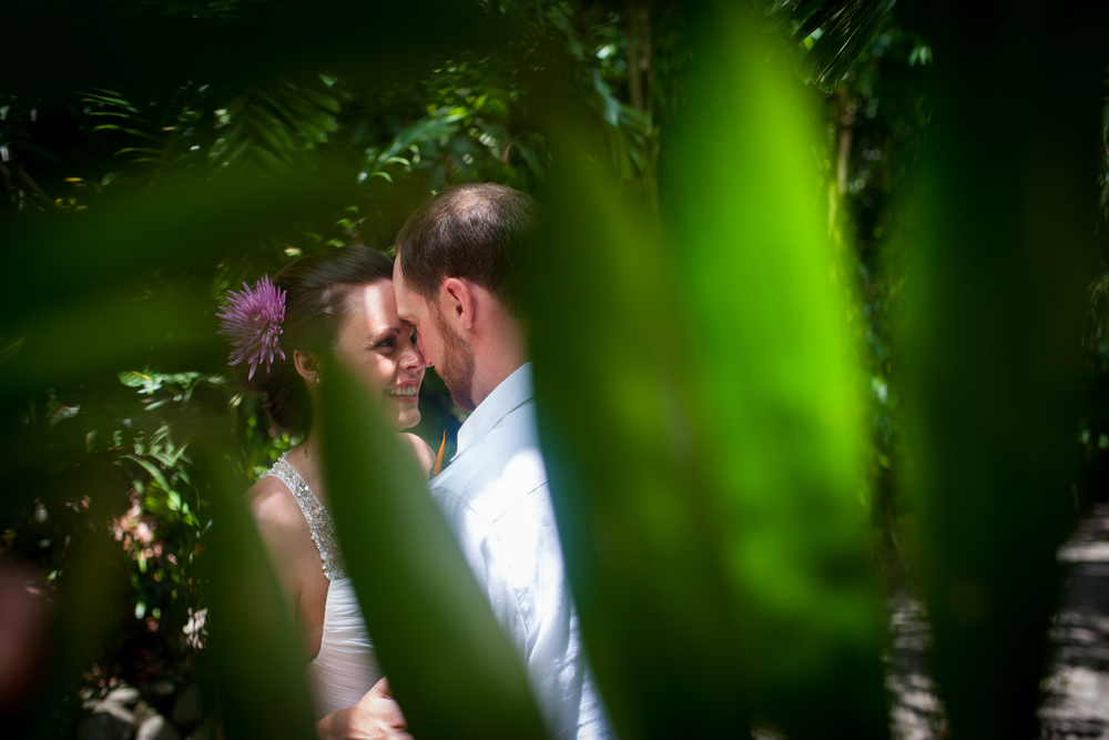 Bride and groom portrait between trees in Costa Rica