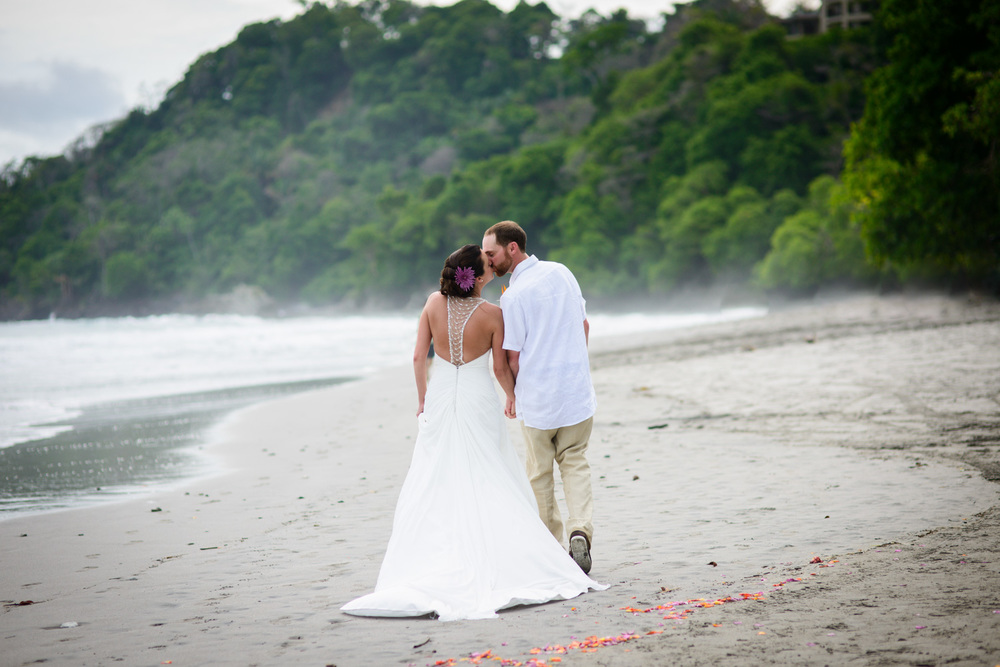 Bride and Groom kiss on beach manuel Antonio Costa Rica wedding