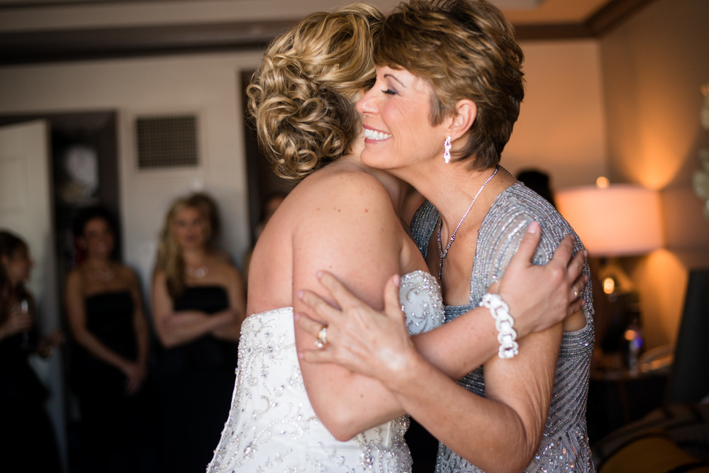 excited mom hugs bride at colorado wedding
