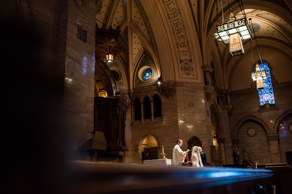 bride and groom take communion at Holy Ghost Cathedral