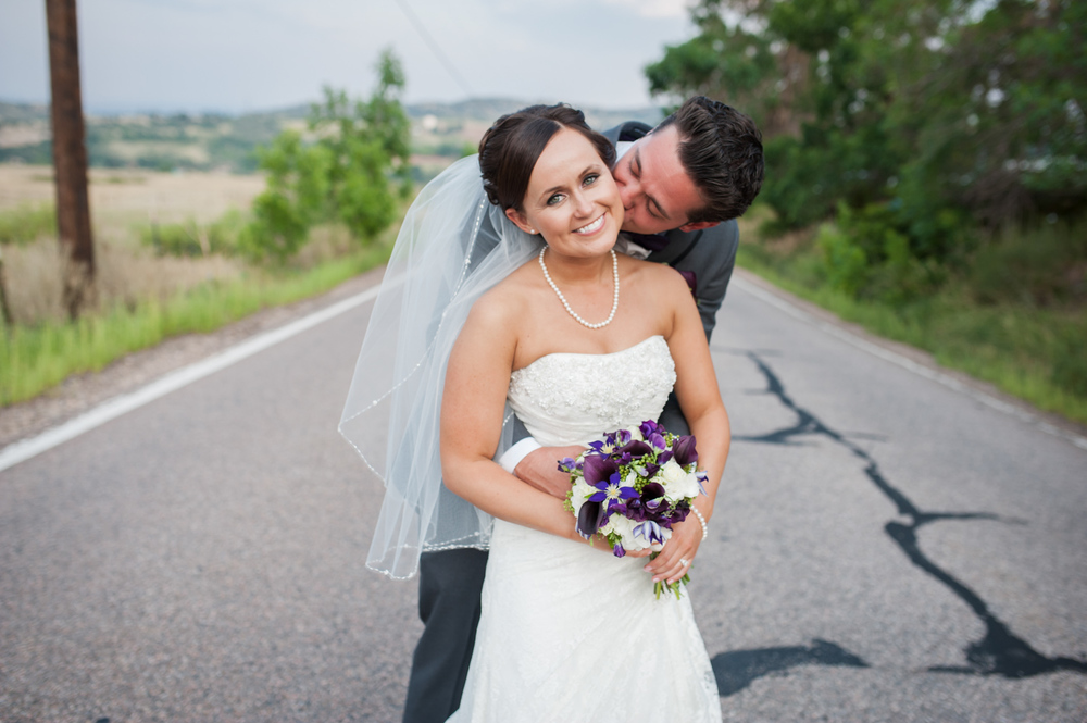 Groom kisses Bride in middle of road