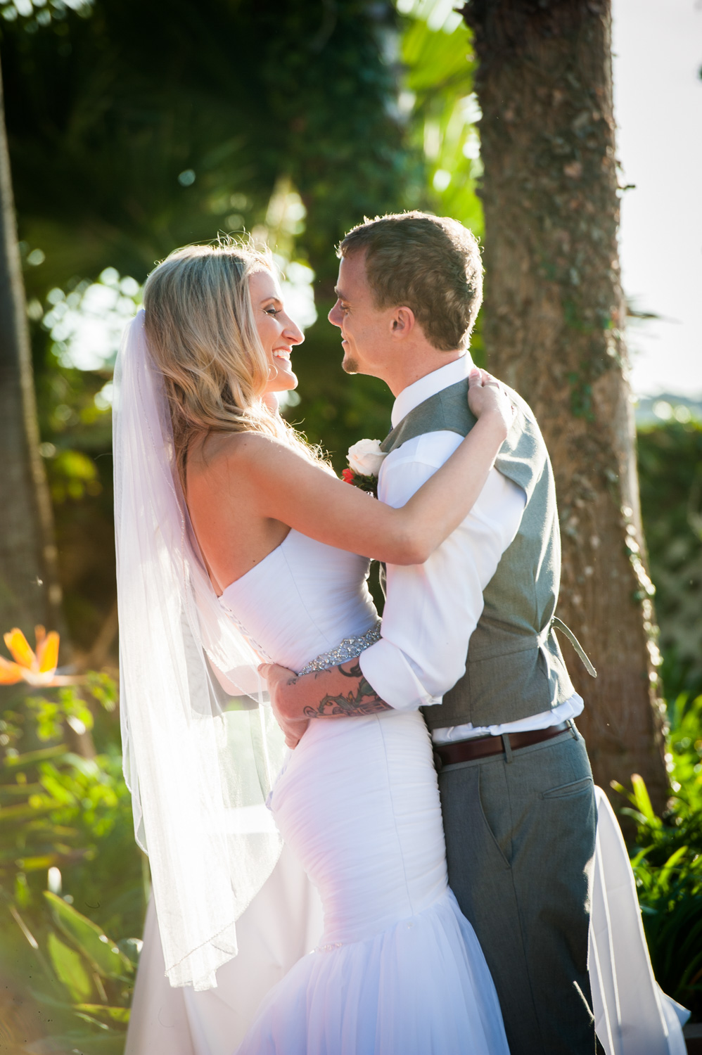 Bride and Groom hug during sunny California ceremony