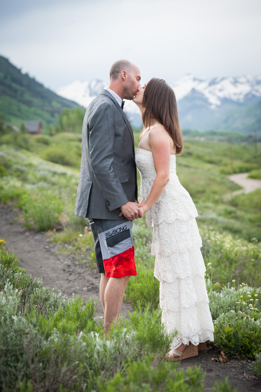 Bride and Groom kiss in Crested Butte meadow