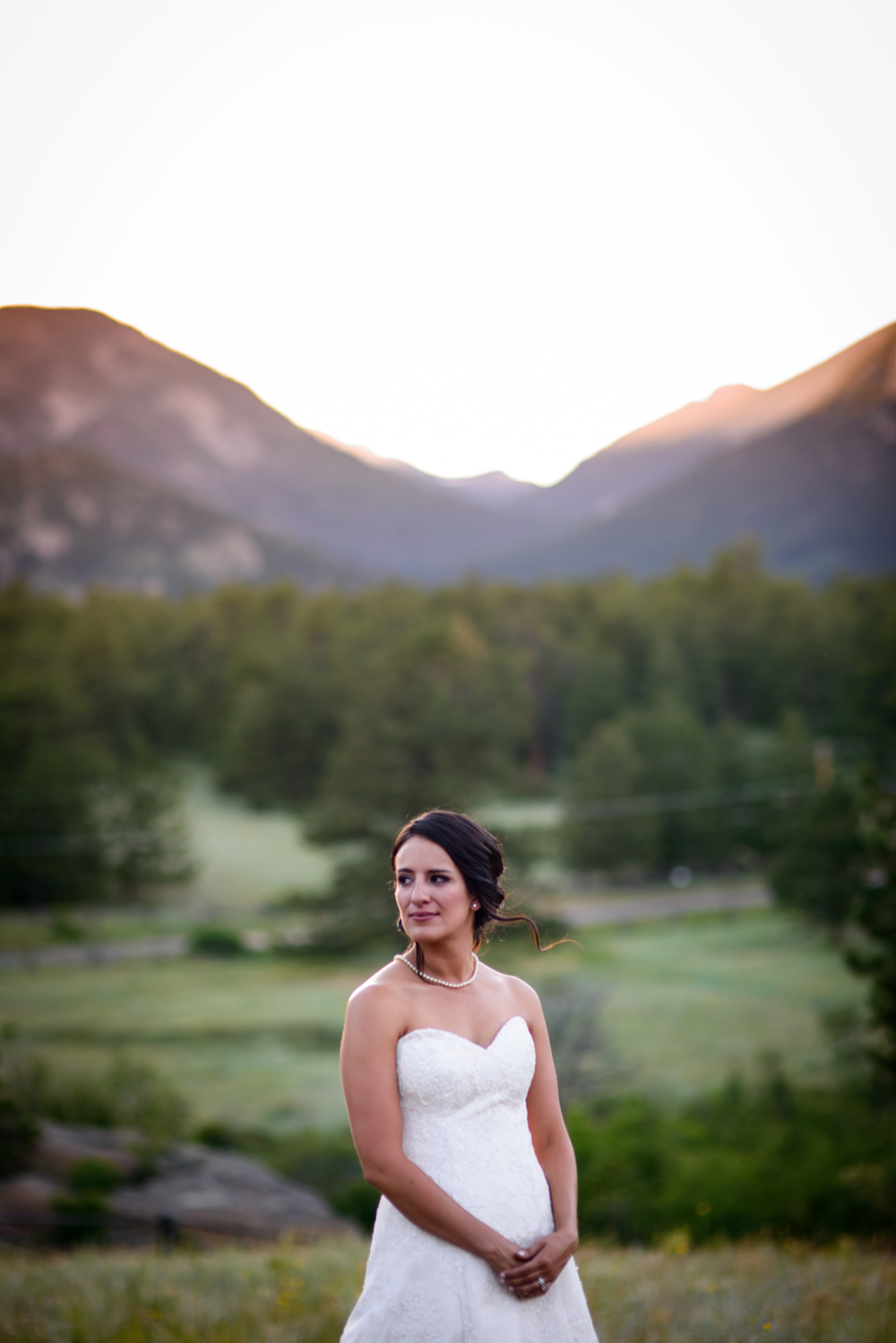 bride in front of mountain sunset in Estes Park
