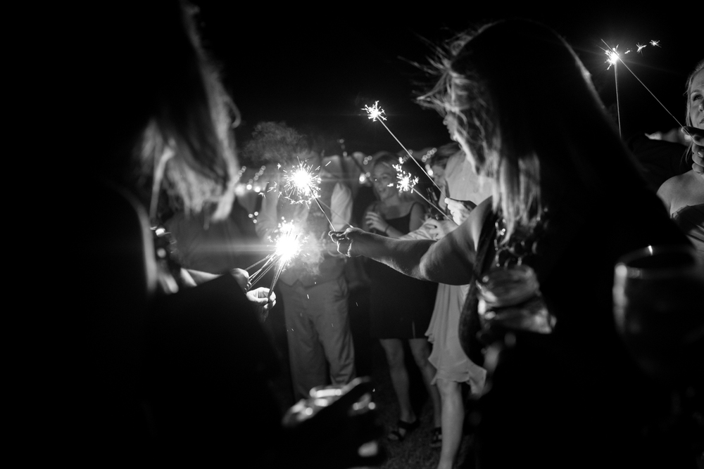 creative portrait of sparklers at wedding