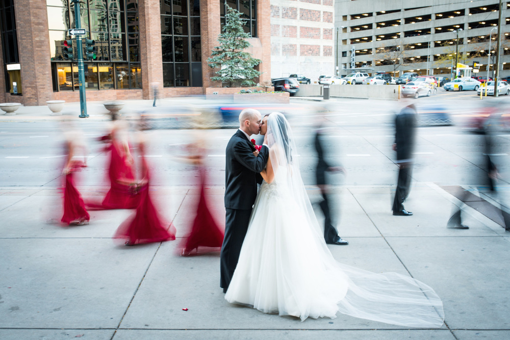creative movement portrait of wedding party in Denver