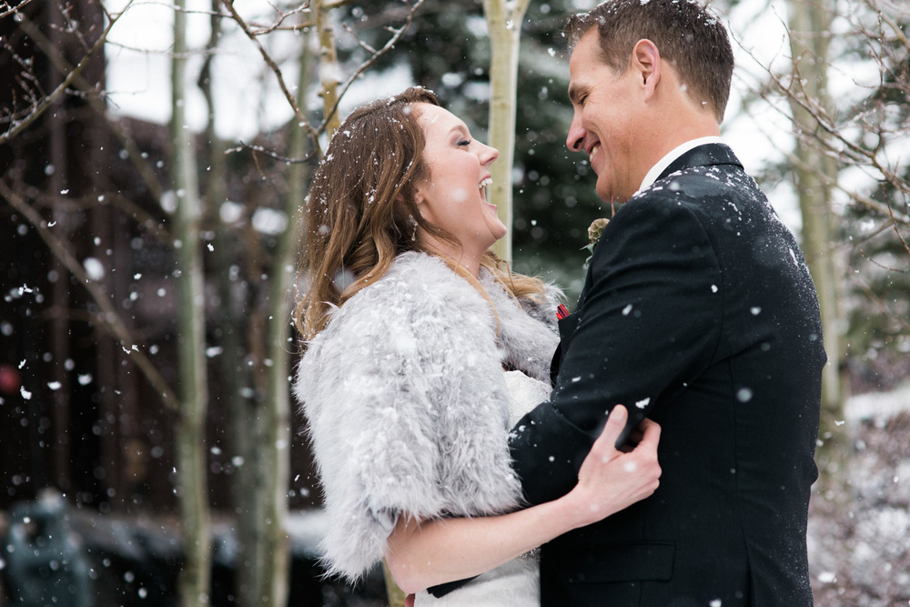snowy mountain wedding couple at Devils Thumb Ranch