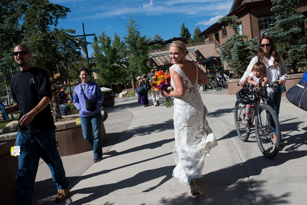 bride laughs as walking through Winter Park village