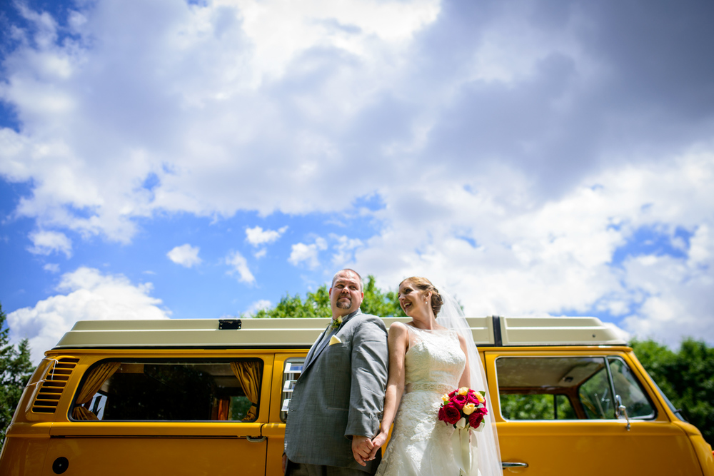 wedding couple in front of yellow volkswagon bus