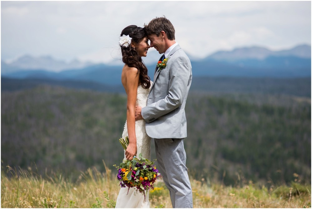 bride and groom embrace on colorado mountain top