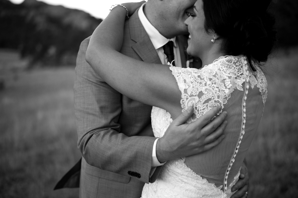 creative black and white portrait of bride and groom hugging